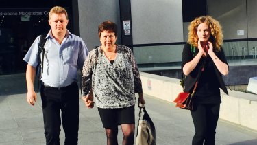 The mother and sister of Rebekka Meyers leave court on the first day of an inquest into her death at a Brisbane intersection.
