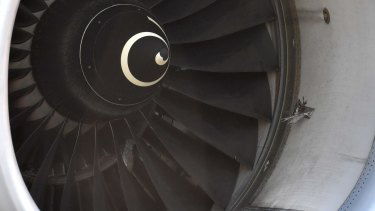 A closer view of the damaged engine of the grounded plane.
