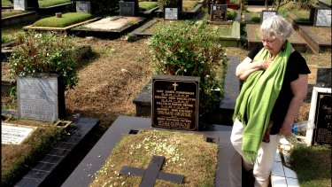 Widow Shirley Shackleton visiting the grave of her dead husband, Greg Shackleton who was killed during the Indonesian invasion in 1975.