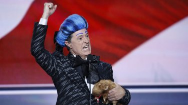 Comedian Stephen Colbert launches the '2016 Republican National Hungry for Power Games' on the stage at the Republican National Convention before being kicked off by security.