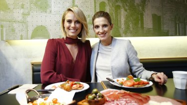 Sylvia Jeffreys, left, and Kate Waterhouse catch-up at Italian Street Kitchen in Neutral Bay.