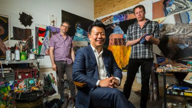 Terry Wu with artists Leslie Eastman and Steven Rendall in the Brunswick East building he has converted into studios.