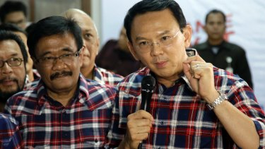 No bull: Ahok, right, with his gubernatorial running mate Djarot Saiful Hidayat, a Muslim, on the campaign trail.