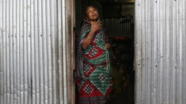 Musammat Khudaja, grandmother of Rubi Akhtar, 12, who died in a stampede, cries at her home.