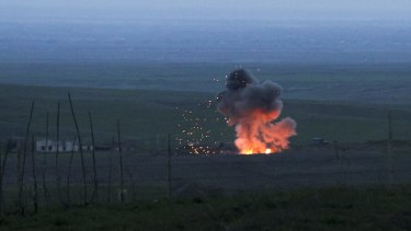 A downed Azerbaijani drone exploding in the separatist region of Nagorno-Karabakh on Monday.