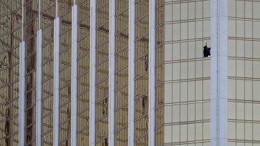 A broken window at the Mandalay Bay resort and casino is seen in the aftermath.