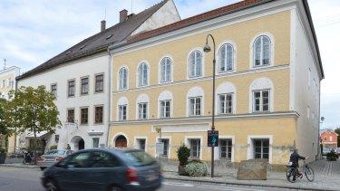 Adolf Hitler's birth house in Braunau am Inn, Austria, on the right.