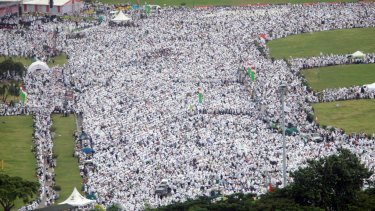 """Indonesian Muslims gather at the National Monument in Jakarta during a rally against governor Basuki """"Ahok"""" Tjahaja Purnama, who is being prosecuted for blasphemy."""