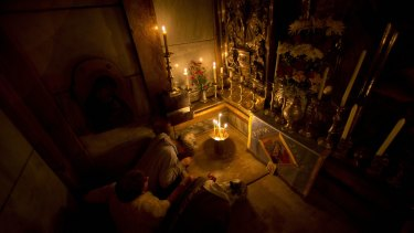 Christians pray at the Church of the Holy Sepulchre.