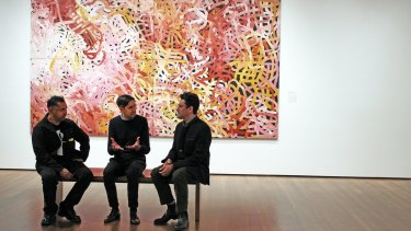 Vernon Ah Kee, Stephen Gilchrist, and Narayan Khandekar at the Harvard Art Museum exhibition in front of Emily Kame Kngwarreye's 1996 painting Big Yams.