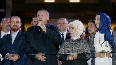 """Turkish President Recep Tayyip Erdogan is flanked by his son Bilal and wife Emine in Gaziantep on October 24. Controversial """"reforms"""" of the judiciary saw corruption charges against Bilal Erdogan dropped."""