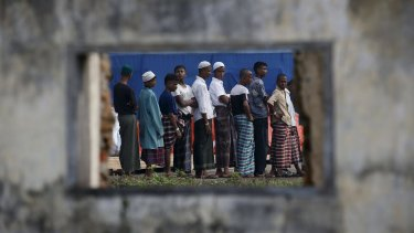 Rohingya migrants wait in line for breakfast at a temporary shelter in Aceh Timur, Indonesia.