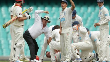 Umpires and players call for help.