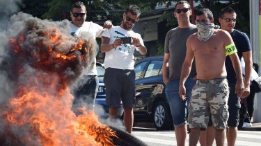 French taxi drivers protest against Uber in the southern city of Marseilles.