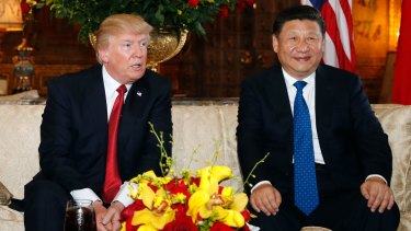 """US President Donald Trump, pictured with Chinese President Xi Jinping at Mar-a-Lago in Florida, is cutting overseas funds in the name of """"America First""""."""