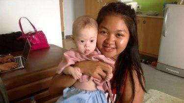 Thai surrogate mother Pattaramon Chanbua poses with baby Gammy in Bangkok, Thailand, last year.