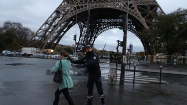 Police clear the Eiffel Tower in Paris on Tuesday.