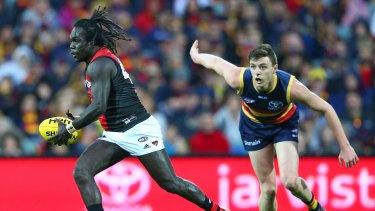 Anthony McDonald-Tipungwuti gets a break on Adelaide's Jake Lever.