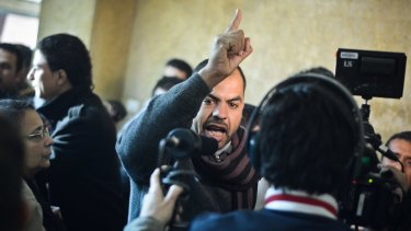 "Family members react in a Cairo court following the acquittal of 26 male defendants accused of ""debauchery""."