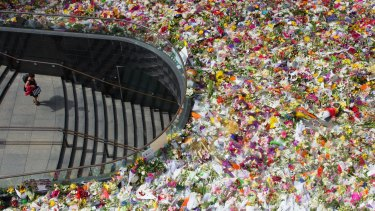 Flowers laid in tribute to the victims of the Sydney siege overwhelmed Martin Place.