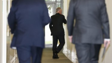 Communications Minister Malcolm Turnbull arrives for the vote.