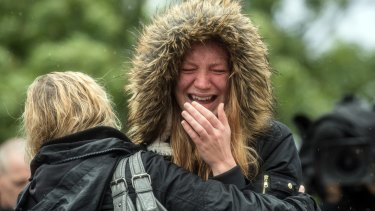 A woman is comforted by her friend on Tuesday as she breaks down in tears after a minute's silence in London near the scene of Saturday's terrorist attack.