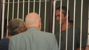 David Taylor speaks with his parents from his holding cell at Denpasar District Court on Tuesday.