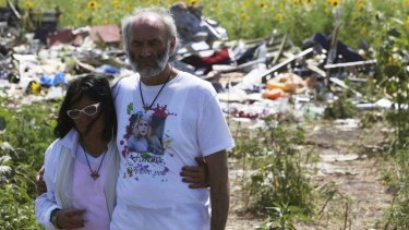 Jerzy and Angela Dyczynski visit the MH17 crash site near the village of Grabovo in Donetsk region on July 26, 2014.