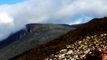 """Sean Rabin swiftly moves the narrative through Hobart and to the """"cold quiet air"""" of Mount Wellington."""