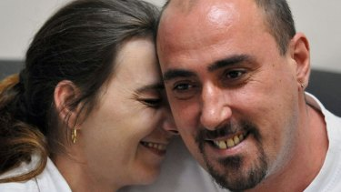 In this March 25, 2008 Serge Atlaoui (right), Frenchman on death row, is seen with wife Sabine Atlaoui (left) during a visit at Nusakambangan prison island.
