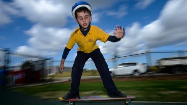 Insight student Christian Kouroumihalis uses echo navigation to skate.