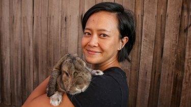 Indie Ladan and her lop ear rabbit Heffie.