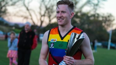 Jason Ball, the first ever openly gay Aussie Rules footballer, with the Pride Cup in 2014.