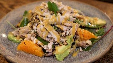 Poached chicken and avocado salad with orange, sugar snap peas, toasted macadamias and honey mustard.
