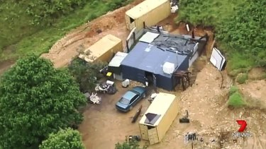 Still from Channel 7 video showing a shed on the property.