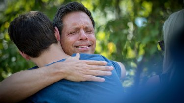 Don Damond was comforted by friends after his fiancee, Justine Damond, was shot by police.