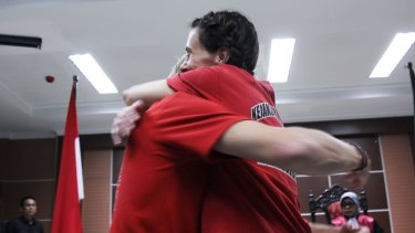 Rebecca Prosser and Neil Bonner embrace after learning they would be released within days.
