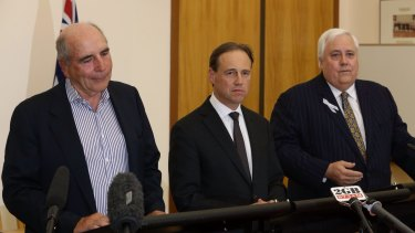 "Environment Minister Greg Hunt says the Climate Change Authority, headed by Bernie Fraser (left), ""might as well do work"" given he has promised not to abolish it under the deal with Clive Palmer (right)."