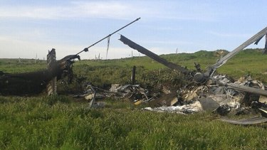 Remains of a downed Azerbaijani forces helicopter lies in a field in the separatist Nagorno-Karabakh region.