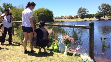 Flowers laid out by a Landsdale lake in tribute to Sam Trott.