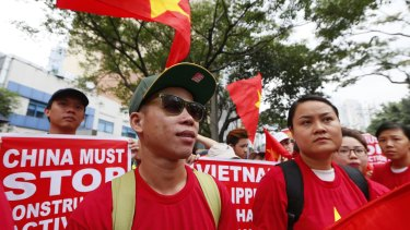 Vietnamese expatriates at a rally held last Thursday at the Chinese consulate in Manila to protest China's island-building and deployment of surface-to-air missiles in the South China Sea