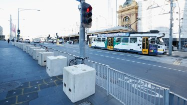 Bollards outside Federation Square and Flinders Street Station.