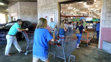 Shoppers arrive at the Costco store in Altamonte Springs, Florida to stock up on supplies.