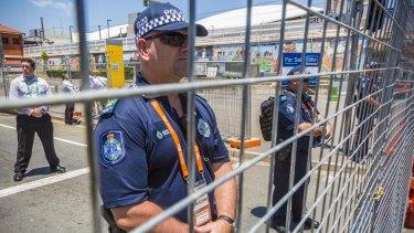 Police watch demonstrators ahead of the G20 summit in Brisbane.