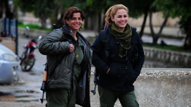 Young women guard the Asayish (Kurdish intelligence agency) headquarters in Tel Tamer, where Islamic State militants had earlier attacked a string of Assyrian villages along the Khabur River, kidnapping at least 220.