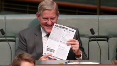 Former Liberal minister Ian Macfarlane holds up an ALP membership form, sent to him during Question Time on Thursday.