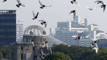 Doves fly over the Peace Memorial Park near the Atomic Bomb Dome at a ceremony in Hiroshima on Thursday.