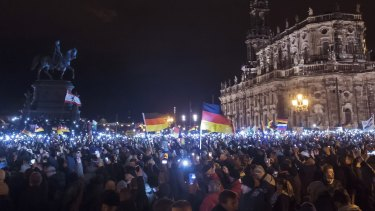 """Mass protest: Thousands of activists gather  in the east German city of Dresden on December 22 for a rally of """"Patriotic Europeans against the Islamisation of the West""""."""