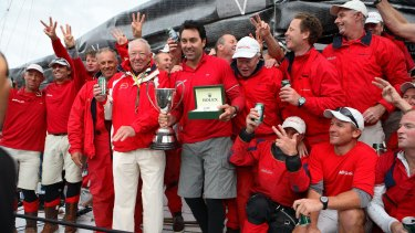 The captain of supermaxi Wild Oats XI Mark Richards (centre with trophy), celebrates with owner Bob Oatley and the Sydney-to-Hobart crew in 2007.