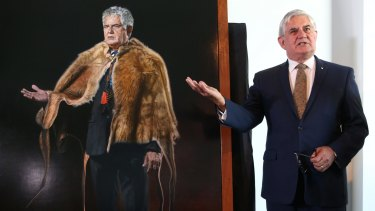 Ken Wyatt, the first indigenous MP in the House of Representatives, with his portrait by artist Mary Moore at Parliament House.